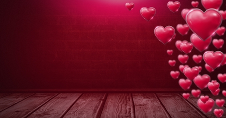 Digital composite of Shiny bubbly Valentines hearts in room with wooden floor
