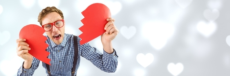 Digital composite of Valentines man breaking heart with love hearts background Stock Photo