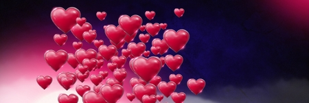 Digital composite of Shiny bubbly Valentines hearts with purple misty background Stock Photo