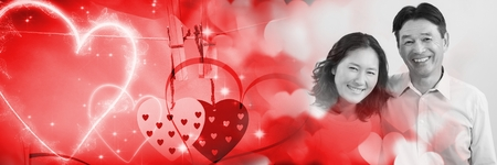 Digital composite of Couple with valentine's love transition hearts Banque d'images