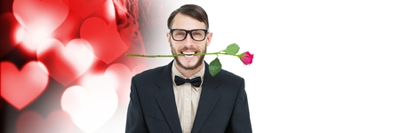 Digital composite of Valentines man biting rose with love hearts background Stock Photo