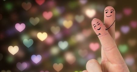 Digital composite of Valentines fingers love couple and bokeh sparkling lights glowing