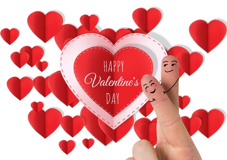 Digital composite of Valentines fingers love couple and Happy Valentines Day text and Paper Valentines hearts Stock Photo
