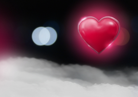 Digital composite of Shiny heart glowing with bokeh misty background Stock Photo