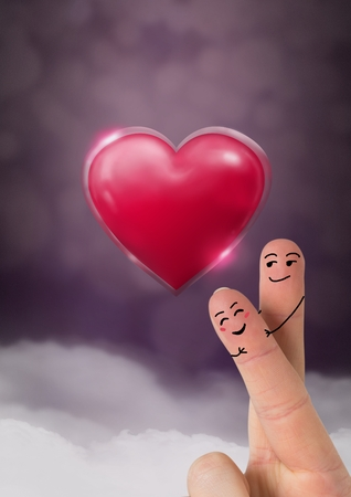Digital composite of Valentines fingers love couple and Shiny heart glowing with purple misty background