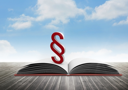 Digital composite of 3D Section symbol icon and book with sky