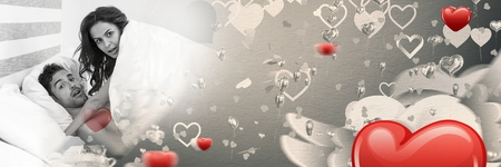 Digital composite of Couple in bed with valentine's love transition hearts