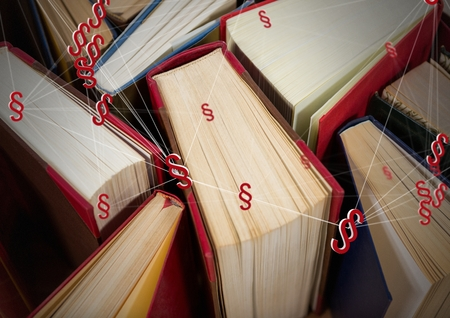 Digital composite of 3D Section symbol icons and books Stock Photo