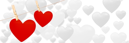 Digital composite of Valentines hanging hearts and love hearts background