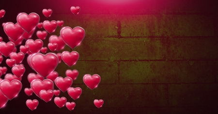 Digital composite of Shiny bubbly Valentines hearts over green wall