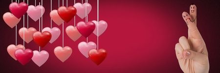 Digital composite of Valentines fingers love couple and hanging hearts