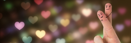 Digital composite of Valentines fingers love couple and bokeh heart lights glowing Stock Photo