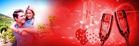 Digital composite of Couple giving piggyback with valentines love transition and champagne glasses and hearts