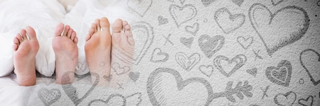 Digital composite of Couples feet in bed with valentines love transition hearts