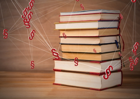 Digital composite of 3D Section symbol icons and books stacked up