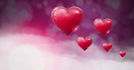 Digital composite of Shiny bubbly Valentines hearts with purple bokeh misty background Stock Photo
