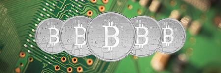 Bitcoin against green ed circuit board Stock Photo