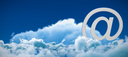 At e-mail symbol against low angle view of white clouds against sky Stock Photo