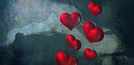 red hearts against rusty weathered wall
