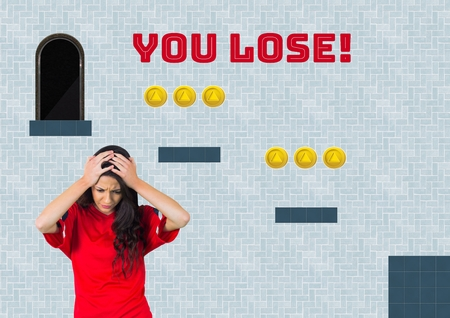 Digital composite of You Lose text and woman in Computer Game Level with coins Stock Photo