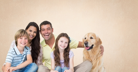 Digital composite of Family with dog and orange background