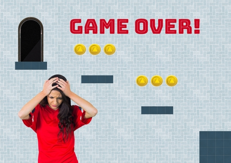 Digital composite of Game over text and woman in Computer Game Level with coins