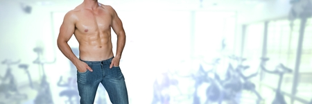 Digital composite of Fit strong Man in gym wearing jeans