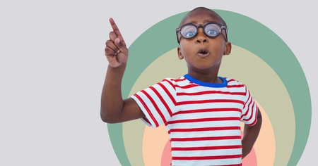 Digital composite of Boy pointing with colorful circles