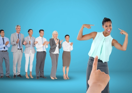 Digital composite of Hand choosing a business woman on blue background with business people