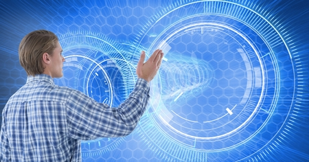 Digital composite of Man touches circle interface on wall