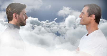 Digital composite of Men looking at each other through clouds Stock Photo