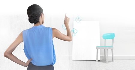 Digital composite of woman pointing with blank canvas