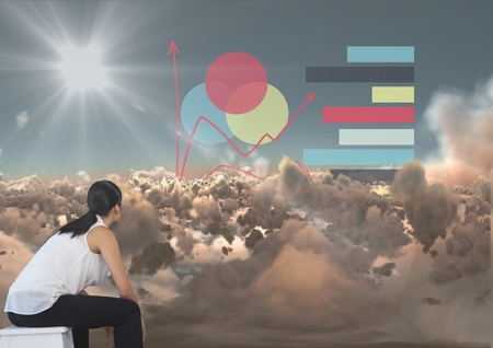 Digital composite of Woman looking out over clouds at graphs and data Stock Photo