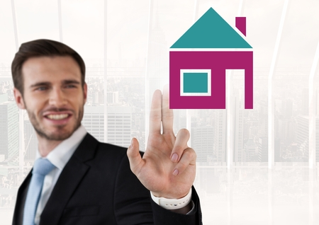 Digital composite of Businessman touching house icon