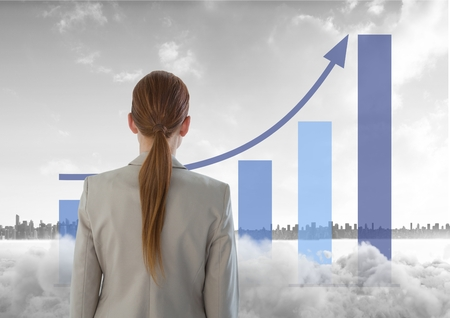 Digital composite of Woman looking out at city with a graph and smoke in front of her Stock Photo