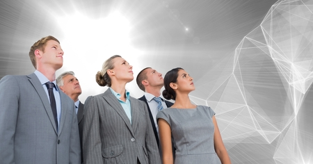 Digital composite of Business people group looking upwards