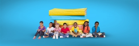 Digital composite of Children sitting on the floor and a pile of books with blue background