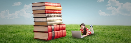 Digital composite of Woman using computer and laying on the floor next to a pile of books outdoors
