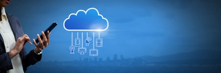 Digital composite of Hand holding phone with cloud icon and hanging connection devices
