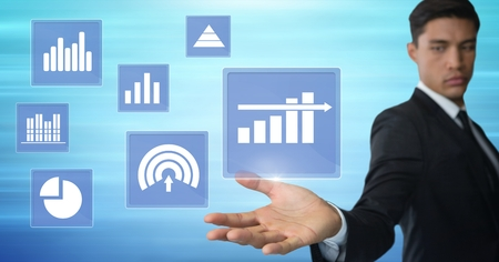 Digital composite of Businessman touching business chart statistic icons