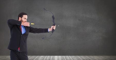 Digital composite of Businessman shooting arrow Stock Photo