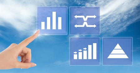 Digital composite of Hand touching business chart statistic icons