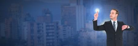 Digital composite of Businessman touching light in dark city