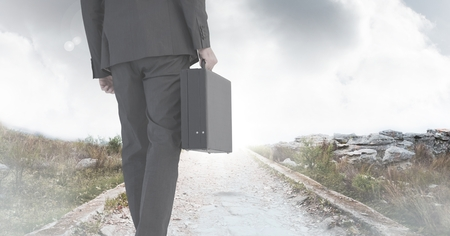 Digital composite of Businessman holding briefcase on path Stock fotó