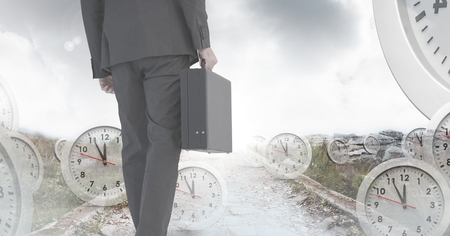 Digital composite of Businessman holding briefcase with surreal clocks time transition Stock fotó - 97243480