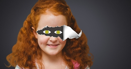 Digital composite of Girl with torn paper on eyes and drawn eyes