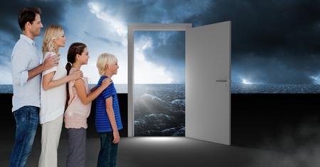 Digital composite of Family standing by open door with dark sea glow and surreal sky