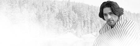 Digital composite of Man under blanket in front of forest landscape Stock Photo