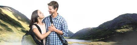 Digital composite of Travelling couple with bags in front of landscape