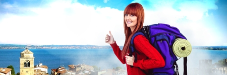 Digital composite of Travelling woman with bag in front of holiday landscape